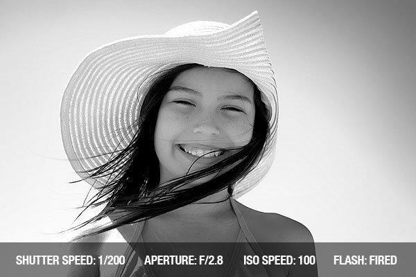 Beach Photography - Smiling girl posing on a beach