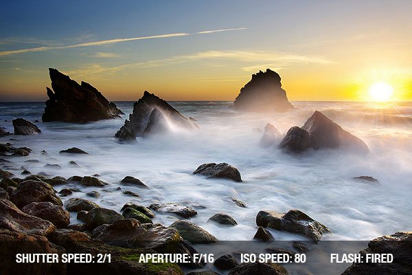 Beach Photography - Seascape with the ocean in motion at sunset in Adraga Beach, Portugal.