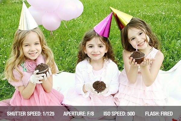 Three young girls outdoors merry, celebrate a birthday, give gifts