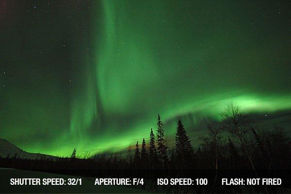 Night sky with faint Aurora borealis