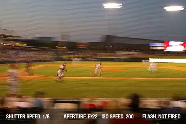 Baseball player running to first base