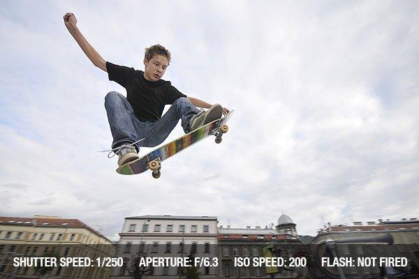 Boy practicing extreme skateboarding