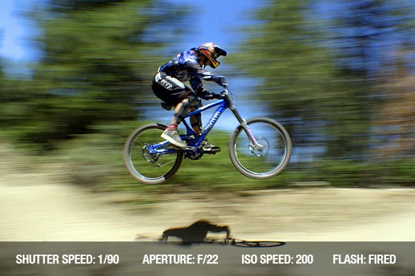 Extreme downhill race - Mountain bike racer catching air