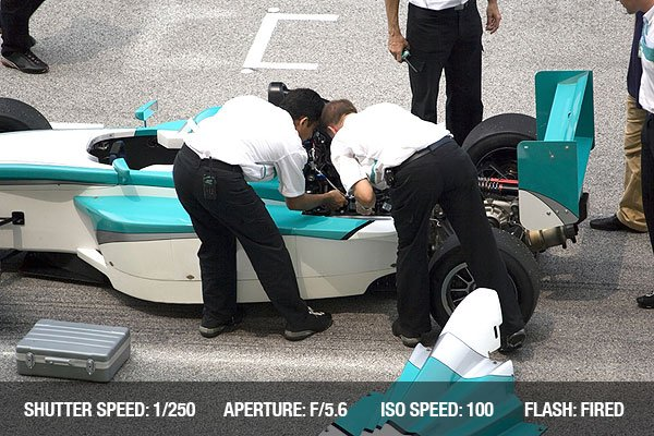 Stalled grand prix car being repaired at the starting grid