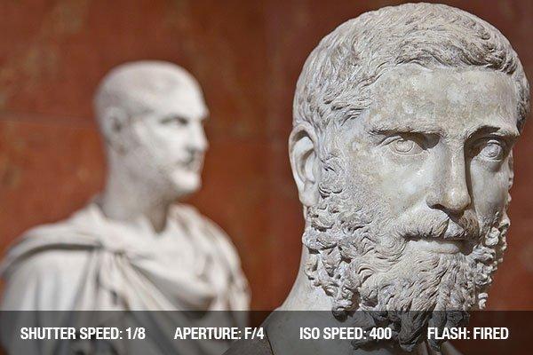 Close up of a male statue in a museum, modern copy of a Greek original.
