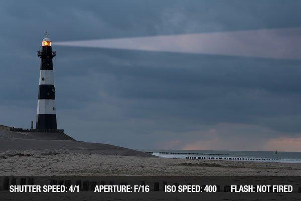 Vuurtoren Breskens lighthouse in the Netherlands shining in the night