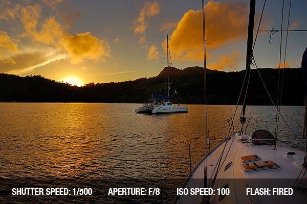 Sailing Photography - Sailing boat floats against beautiful sunrise