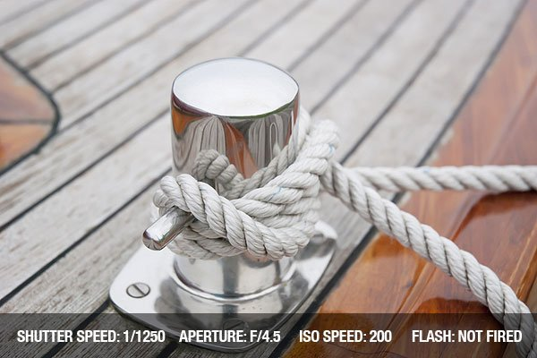 Ship Knotted Onto Pier With White Rope