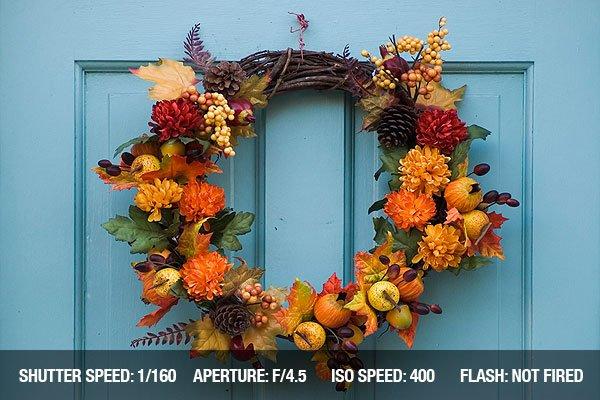Thanksgiving wreath hanging on residential door