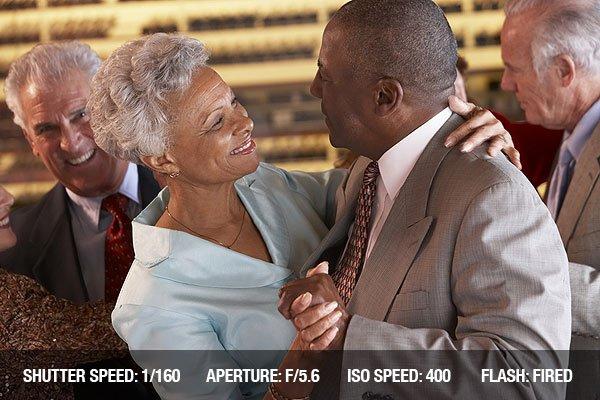 Senior Couples Dancing Together At Wedding Reception